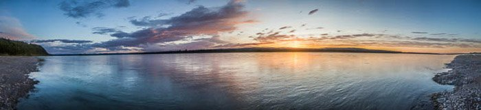 A stunning panoramic image of a seascape at evening time