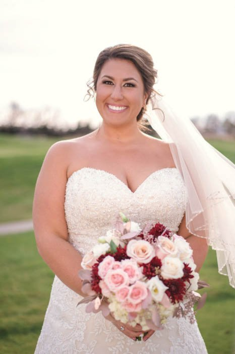 wedding portrait of a bride with reflectors used for lighting