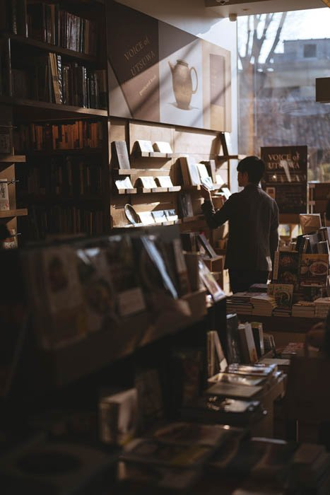 a man browsing in a bookstore