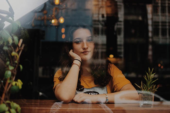 A portrait of a woman in a cafe