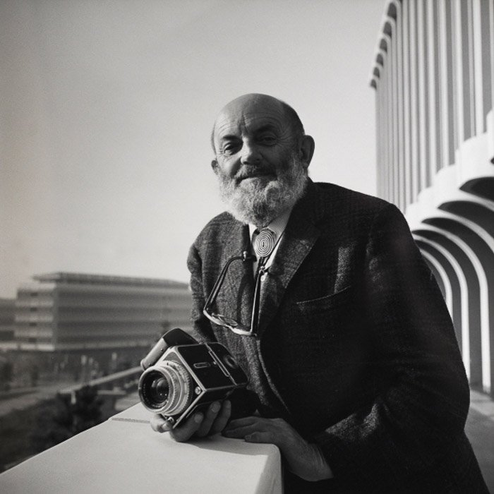 A black and white portrait of famous photographer Ansel Adams