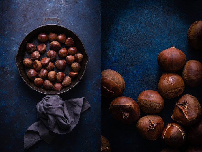 Chestnuts sit in a pan on a dark blue background
