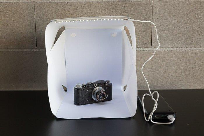 A photoshoot setup containing a camera in a diy light box