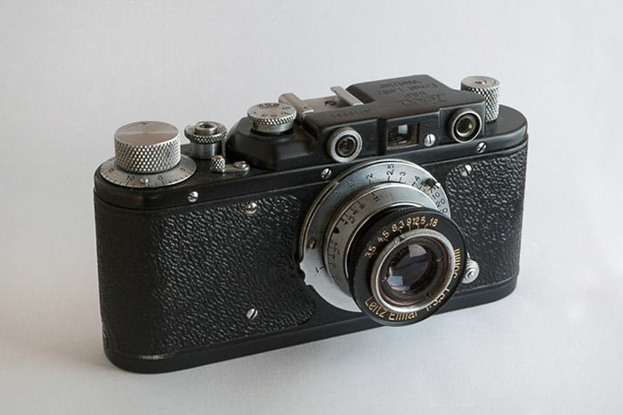 A close up of a film camera on white background - how to make a light box photography