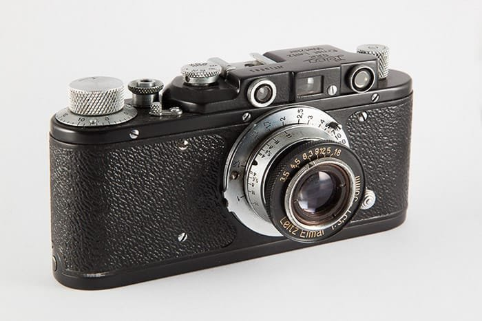 A close up of a film camera on white background - how to make a light box tutorial