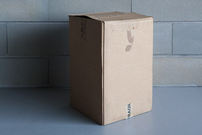 A cardboard box beside a stone wall for making diy lightbox phoography
