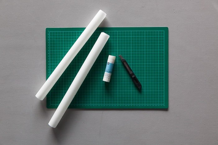 Overhead shot of a tools you need to make your own photography light box