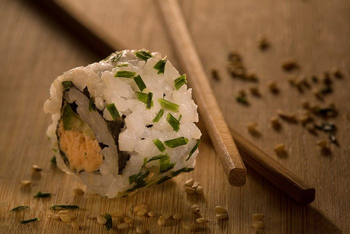 A close up shot of a sushi roll with DIY photography studio lighting