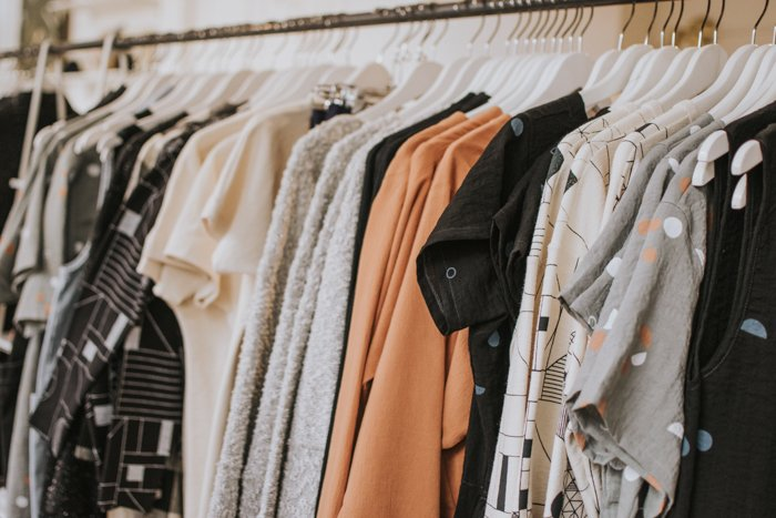 A rack of clothes at a fashion photography shoot
