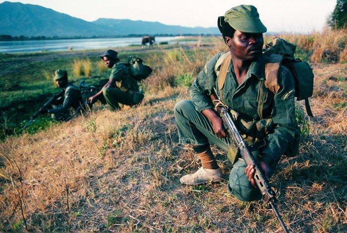 Soldiers in a field by Deborah Copaken female photographer