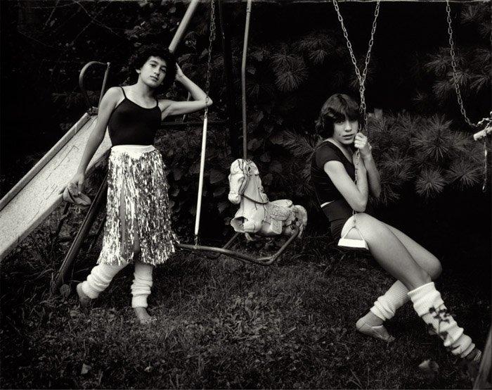 Portrait of kids on swings by Sally Mann