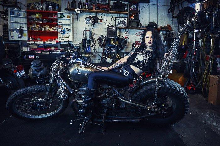 Female model posing on a motorbike