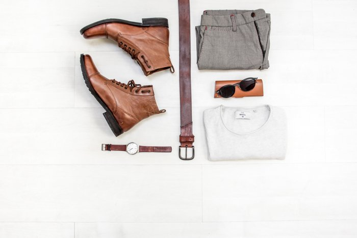 Flat lay product photo of shoes, watch, belt and clothes