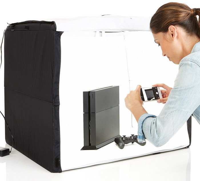 A person taking product photography in a mobile studio