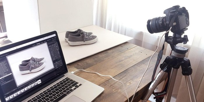 An image showing that tethering your camera allows you to see your product photography on your computer or laptop
