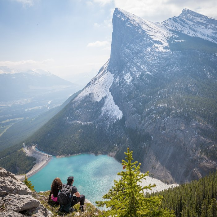 Image of travellers surrounded by a beautiful landscape