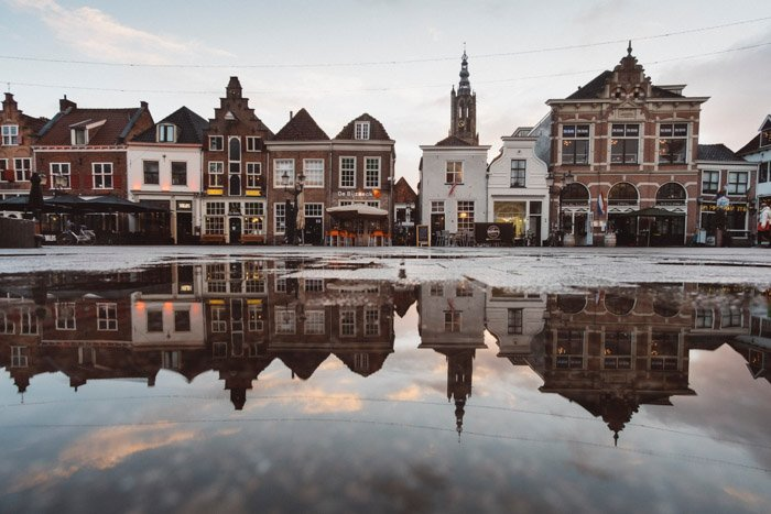 A great travel photograph with reflections and composition of a village