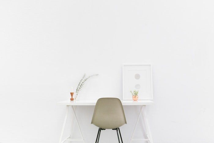 A chair and desk in front of a white background