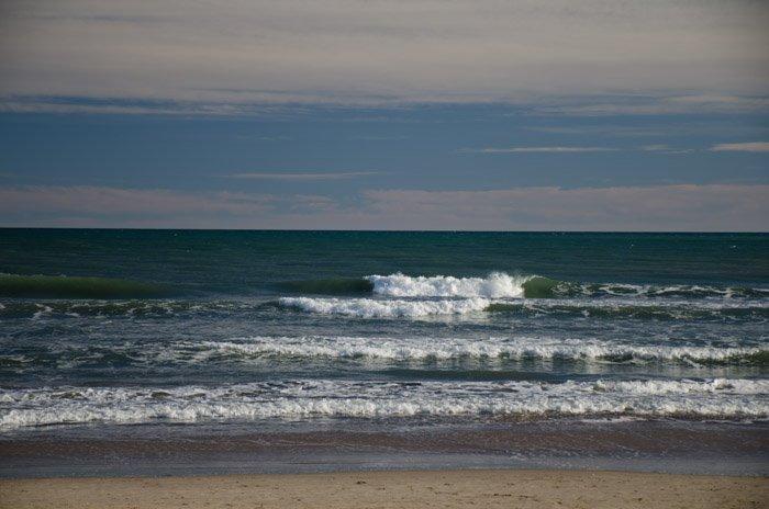 Photo of waves at the seashore shot using a polariser filter.