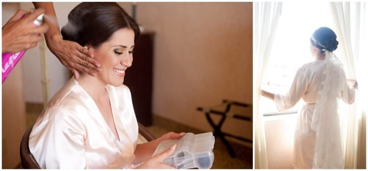 Bride getting ready for her wedding with someone putting hairspray on her hair.