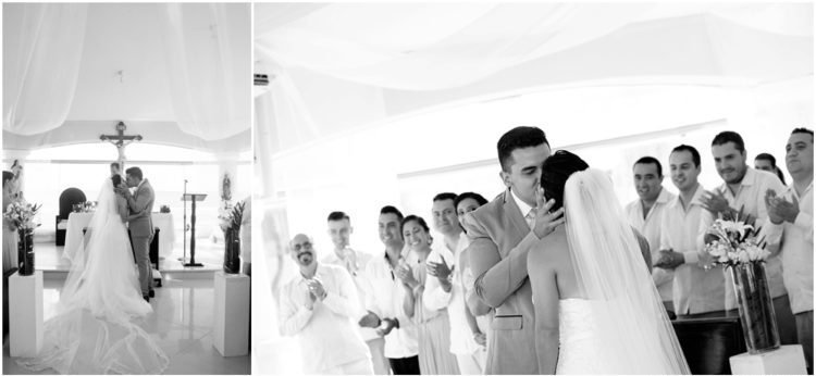 A black and white picture of a married couple's first kiss as husband and wife at the wedding ceremony