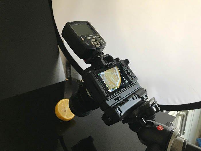 A camera capturing a closeup shot of a lemon