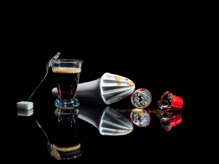 Commercial photo of coffee making equipment on black background