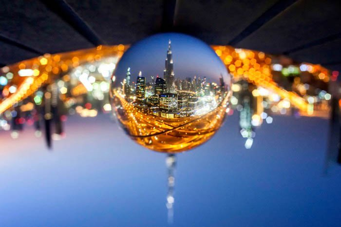 crystal ball photography of a city upside down