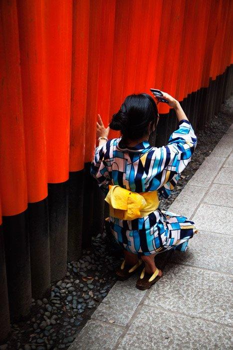 picture of a girl wearing a colourful kimono taking selfies