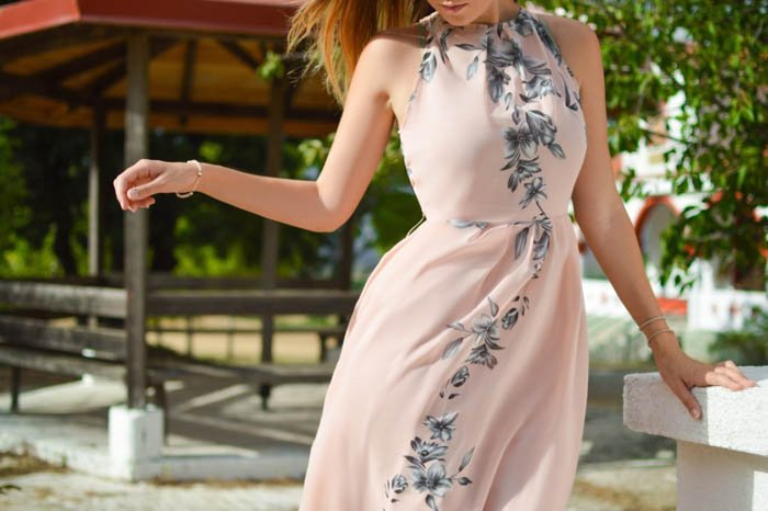 A female photography model posing outdoors wearing a summer dress - fashion photography composition