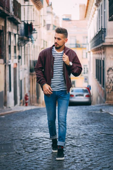A male model walking casually outdoors - fashion photography composition