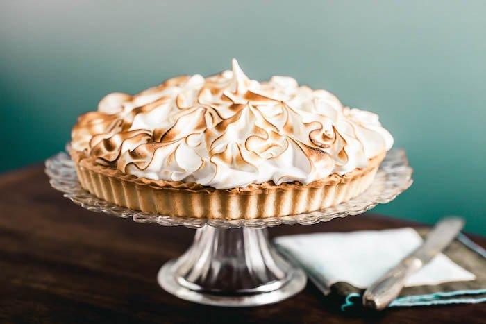 Lemon meringue tart on a cake stand