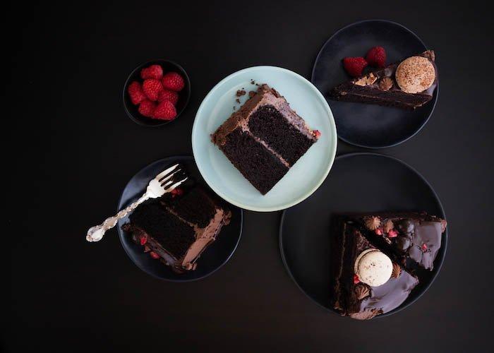 Chocolate ganache layer cake slices on dark background