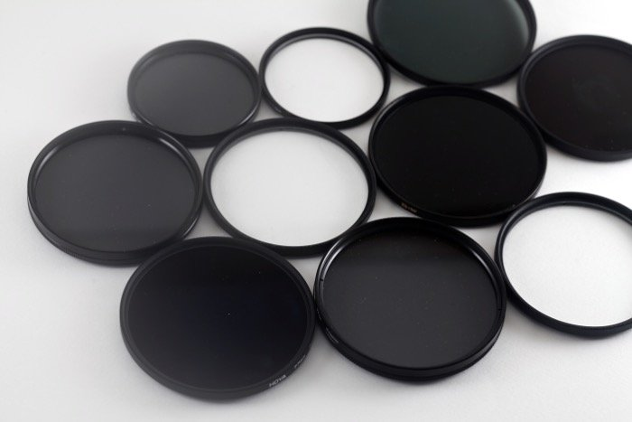 A flat lay of various lens filters for travel photography