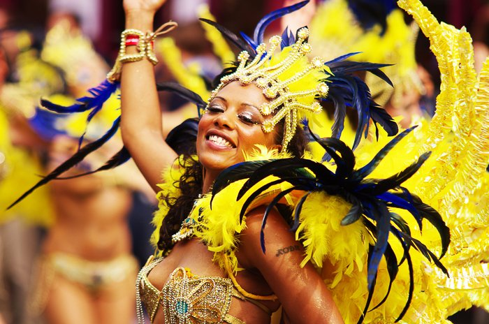 A portrait of a carnival dancer in flamboyant yellow feathered dress