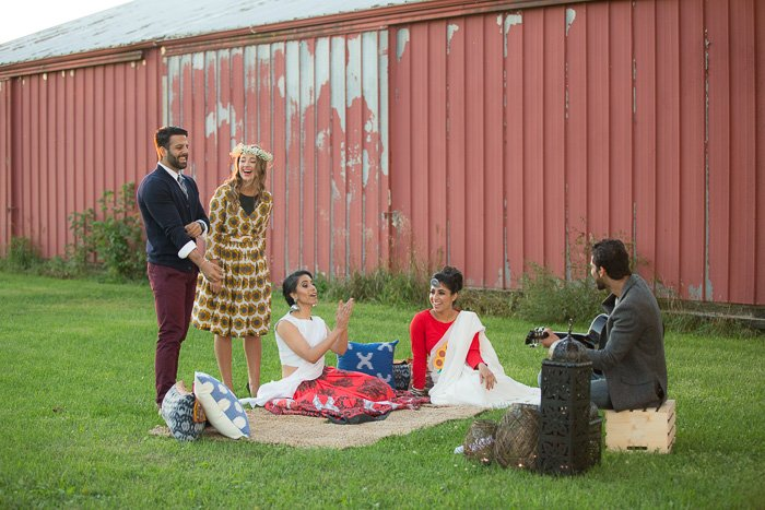 Outdoor fashion shoot involving a styled outdoor picnic with two men and three women in Indian-Fusion outfits and accessories.
