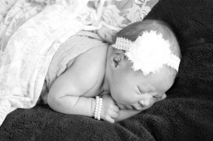 Wait until your newborn is nice and sleepy for the best use of your newborn photography shoot