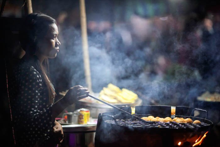 A street food vendor at work at night