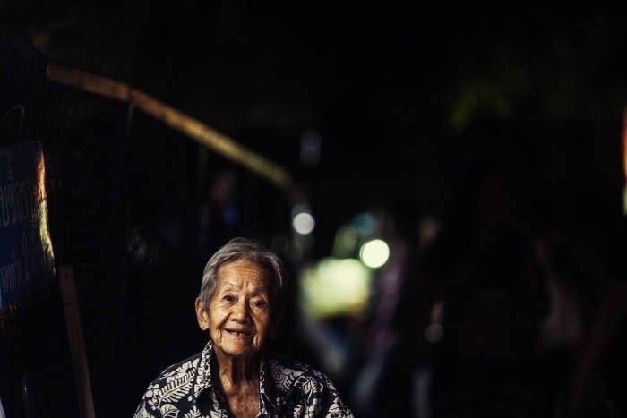 A night portrait of an elderly woman