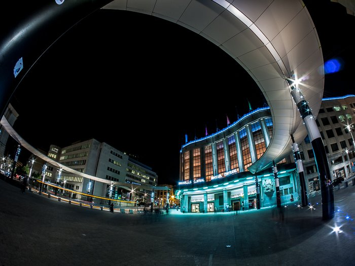 Dramatic distorted view of the main entrance of Brussels Central Station at night taken with fisheye lens. Architectural photography