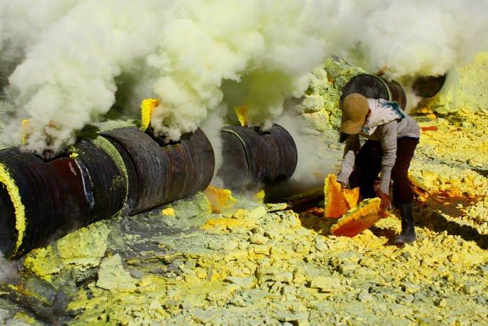 An image of a man mining sulphur - travel photography