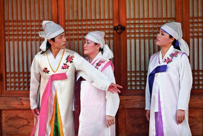 Three people dressed in traditional clothing