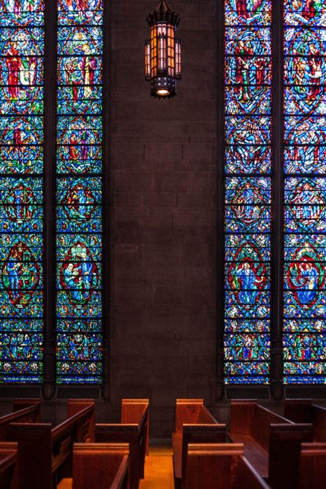 symmetry composition rule used in the photo of a chapel's stained glass windows