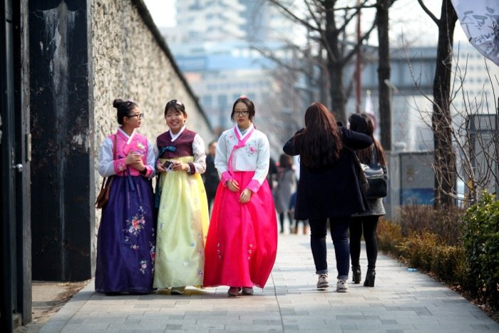 street photography showing three South Korean girls wearing traditional clothing known as Hanbok