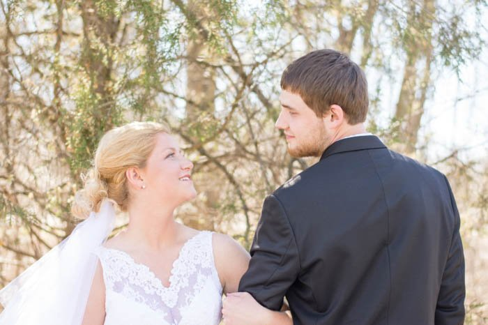 Bride and Groom wedding pose arm in arm outdoors