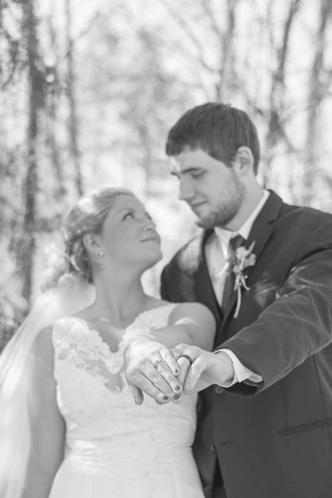 Black and white wedding portrait of the couple posing outdoors