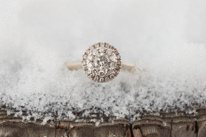 close up photo of engagement ring in ice