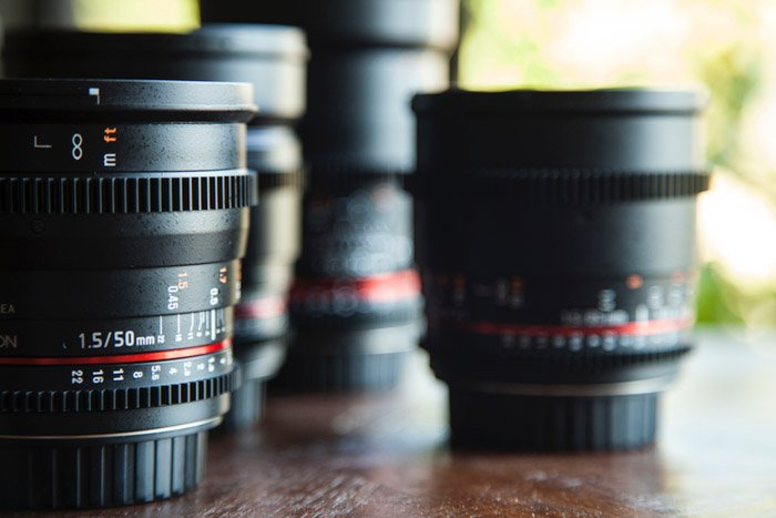 a selection of camera lenses for adventure photography