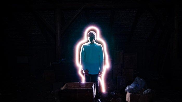 Creative portrait of a man lit with a light stick
