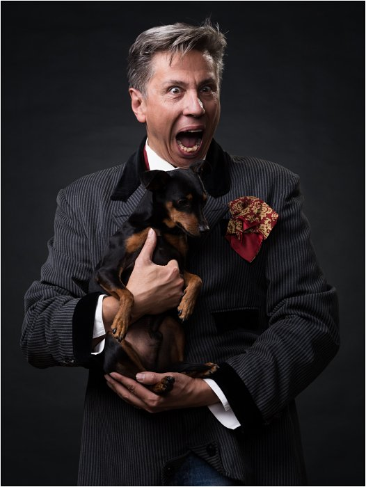 Humorous photo of a man holding a dog